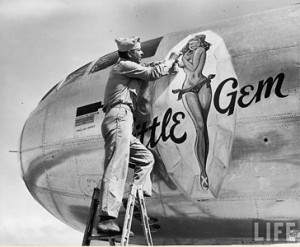 World War 2 - Servieman paints Nose Art on a B-29