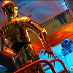 C-3PO directs R2-D2 while performing checks on a Starspeeder 3000