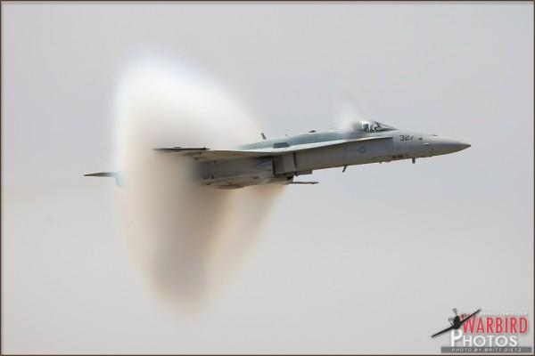 A Boeing F/A-18C Hornet creates cone vapor at the NBVC Point Mugu Airshow 2010