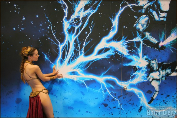 Slave Leia (Christy Marie) using Force Lightning against two Stormtroopers