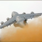 With a massive dust cloud trailing behind it, a C-17 Globemaster III takes to the skies over the 2008 Riverside Airshow