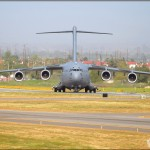 The C-17A Globemaster III backs into position on the runway at Riverside Airport