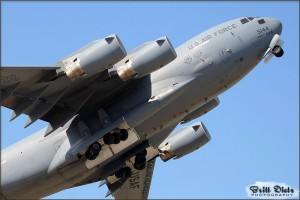 Climbing high into the sky at a rapid rate, the C-17 Globemaster III demonstrates a tactical takeoff