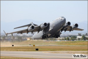 A C-17 Globemaster III raises up into the skies at the 2010 Riverside Airshow