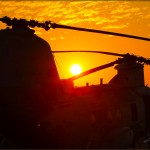 The sun sets in the San Diego sky behind a CH-46E Sea Knight at MCAS Miramar