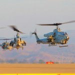 AH-1W Cobras hover in to their landing spots followed by UH-1N Hueys