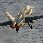 An F/A-18c Hornet is launched off the deck of the USS Abraham Lincoln Aircraft Carrier