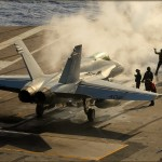 An F/A-18C Hornet preps for being launched off the deck of the USS Abraham Lincoln Aircraft Carrier