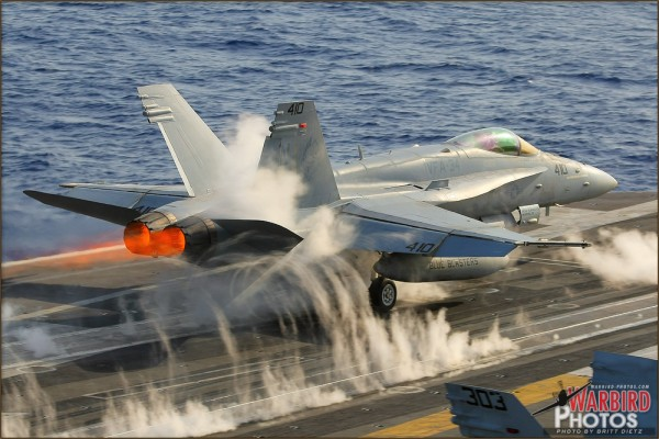 An F/A-18C Hornet launches off the USS Abraham Lincoln Aircraft Carrier