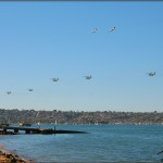 Marine CH-53 Super Stallions and C-130K Hercules pass in review for the Centennial of Naval Aviation Celebration 2011