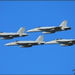 Four US Navy F/A-18E Super Hornets pass in formation at the Centennial of Naval Aviation Celebration 2011
