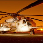 A Sikorsky CH-53E Super Stallion sits at night at the Gillespie Field Airport