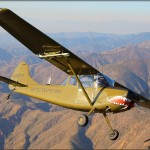 A Cessna O-1E Bird Dog banks over the El Toro, California mountains