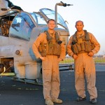 The pilots of the US Marine AH-1Z Viper pose with their helicopter before taking off