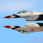 The two USAF Thunderbird solos pass in a tight inverted formation at the Nellis AFB Airshow 2011